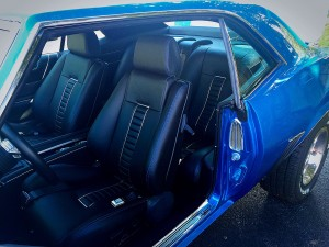Custom seats with blue stitching